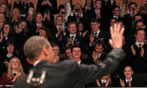 Barack Obama waves to students at Belfast Waterfront.