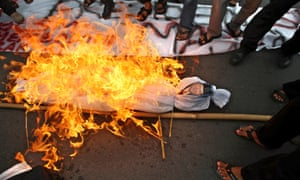 Protesters burn an effigy of the Indonesian president, Susilo Bambang Yudhoyono, during a rally in Surabaya against the government's plan to raise fuel prices.