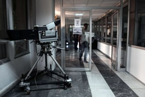 A man walks inside the Greek state television ERT headquarters on June 16, 2013 in Athens.