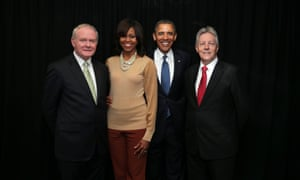 Say cheese! First Minister Peter Robinson, right, and deputy First Minister Martin McGuinness pose for a souvenir photo with Barack and Michelle Obama at the Waterfront Hall in Belfast.