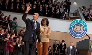 Barack and Michelle Obama wave to the crowd in the Belfast Waterfront Hall