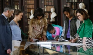 US first lady Michelle Obama with her daughters Sasha, and Malia, second from the right, look through archives documenting the Obama's Irish Ancestry during their visit to the Old Library at Trinity College, in Dublin, Ireland.