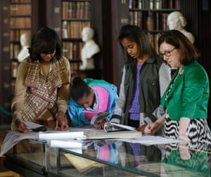 Michelle Obama with her daughters Sasha, and Malia, look through archives with Genealogist Fiona Fitzsimons documenting the Obamas' Irish Ancestry during their visit to the Old Library at Trinity College, in Dublin. The first lady and her daughters were given a presentation on their family genealogy and connection to Ireland.