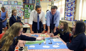 President Obama joins David Cameron in admiring the artwork of children at Enniskillen Integrated Primary School in Northern Ireland ahead of the official start of the G8 summit at the nearby Lough Erne resort.