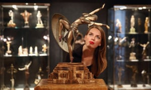 A statue by Demetre Chiparus entitled 'Almeria' is viewed at Bonham's auction house in London where it is expected to fetch around £300,000. The artwork features in Bonhams' '20th Centenary Decorative Arts' sale which is to be held on June 19 and includes furniture and artworks from the art deco period.
