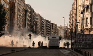Tear gas billows through the streets of Istanbul as police launch a charge against demonstrators in continuing civil unrest in Turkey.