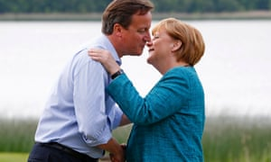 David Cameron welcomes Germany's Chancellor Angela Merkel to the Lough Erne golf resort for G8 summit.