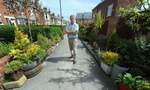 This seems a bit potty! Resident Michael Kelley is photographed in Rockcliffe Avenue, Whitley Bay in North Tyneside which is lined with flowerpots. It is past winner of 'the street in bloom award' given by the council. The residents have now been told to remove the pots by the same council for health and safety reasons due to being an obstruction.