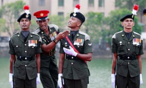 Chin up! A Sri Lankan army officer inspects soldiers prior to a guard of honour to welcome army Commander Lt. Gen. Jagath Jayasuriya in Colombo. The army commander has been promoted to a Four Star General and will assume duties as Chief of Defense Staff from the beginning of August.