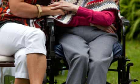 Elderly person with carer.