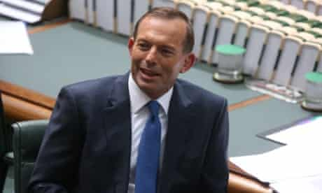 The Leader of the Opposition Tony Abbott watches Wyatt Roy on his feet during question time.