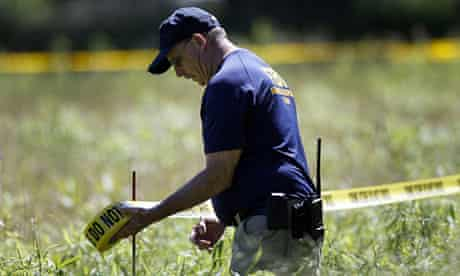 Police tape is searched around a field during the latest search for Jimmy Hoffa's remains