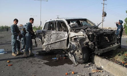 Afghan police at the scene of a car bombing in Helmand province on Monday