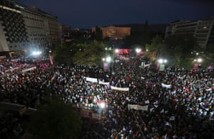 People listen to the speech of Greek leftist opposition leader Alexis Tsipras during a rally against the sudden closure of Greek state broadcaster ERT at central Syntagma square in Athens June 17, 2013.