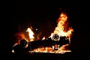 Brazil Protest:: A car burns during a protest in downtown Rio de Janeiro