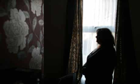 Silouette of a woman by a window
