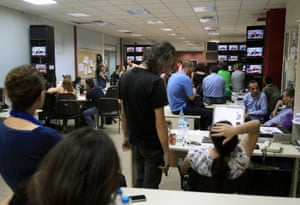 Greek state television and radio ERT employees and journalists listen on TV screens to the statement of PASOK party leader Evangelos Venizelos, after a meeting of the coalition government to discuss the shut-down of state broadcaster ERT at the headquarters  in Athens, Greece, 17 June 2013.