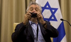 Robert de Niro takes a photo of members of the media prior to his meeting with Israel's president, Shimon Peres, in Jerusalem