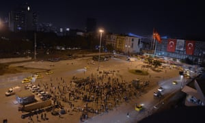 People stand silently on Taksim Square in Istanbul. Erdem Gunduz sparked the imitation in Istanbul and other cities of people standing in passive defiance against the government