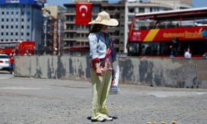 A woman stands during the silent protest at Taksim Square.