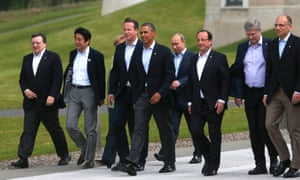 G-8 leaders from left, European Commission President Jose Manuel Barroso, Japan's Prime Minister Shinzo Abe, German Chancellor Angela Merkel, British Prime Minister David Cameron, US President Barack Obama, Russian President Vladimir Putin, French President Francois Hollande, Canadian Prime Minister Stephen Harper and Italian Prime Minister Enrico Letta walk to a group photo opportunity during the G-8 summit at the Lough Erne golf resort in Enniskillen, Northern Ireland.