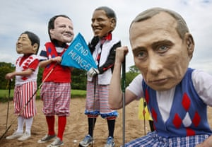Is Putin under par? Oxfam volunteers dress up as Japanese Prime Minister Shinzo Abe, David Cameron, Barack Obama and Vladimir Putin pose in golf clothing as part of their End Hunger campaign in Enniskillen, Northern Ireland during the G8 summit.