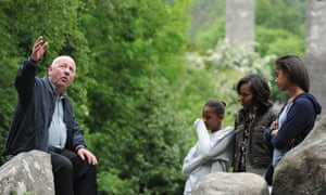 Jet lag? Michelle Obama and daughters, Sasha and Malia look less than thrilled on a visit Glendalough with tour guide George McClafferty in the Wicklow Mountains National Park in Ireland.