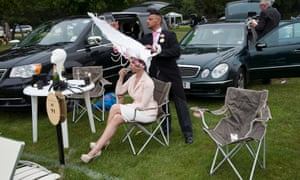 Anneka Tanaka-Svenska has her extravagant hat adjusted by milliner Louis Mariette in the car park before entering the course during Royal Ascot. More more images of Ascot day one see our gallery.