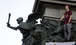 A protester shouts anti-government slogans as he stands on top of a monument during a demonstration in central Sofia. Bulgaria's Socialists, in power for only three weeks, promised today to reform the electoral law in a bid to defuse the street protests that have resumed with new momentum.