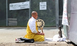 Japanese Buddhist monk and anti-nuclear campaigner Toyoshige Sekiguchi prays at the outer security gate leading to the G8 summit in Enniskillen.