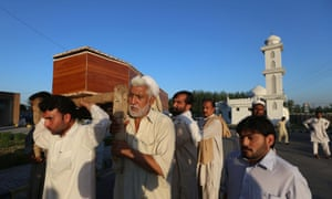 People carry a coffin after a suicide bomb attack in Mardan, Pakistan. At least twenty-eight people were killed, including Imran Khan Mohmand, a member of the provincial parliament, and more than fifty were injured when a suicide bomber targeted a funeral for a local businessman who was shot dead overnight. Photograph: Biliwal Arbab/EPA