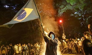 Brazilian protester waves a flag during demonstrations in Sao Paulo