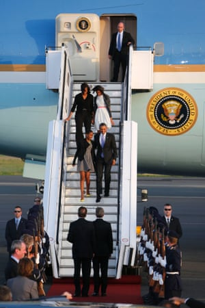 Barack Obama disembarks from Air Force One with Michelle and daughters Sasha and Malia upon his arrival at Tegel airport in Berlin. Obama's first presidential visit to Berlin comes nearly 50 years to the day after John F. Kennedy landed in a divided Berlin at the height of the Cold War.