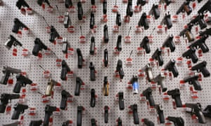 Various automatic handguns are displayed in the weapons vault during an open house for the media at the Alcohol, Tobacco and Firearms National Laboratory Centre in Beltsville, Maryland. The ATF marks its 10th anniversary this week.