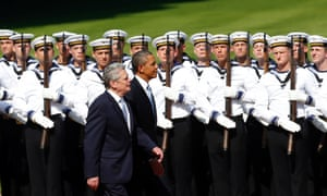 Barack Obama reviews an honour guard with German president Joachim Gauck at Schloss Bellevue in Berlin, Germany. Obama will unveil plans for a sharp reduction in nuclear warheads in a landmark speech at the Brandenburg Gate today.
