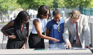 Michelle Obama, her daughter Sasha, and Barack Obama's half sister Auma are shown around the Holocaust Memorial in Berlin during a visit to Germany.