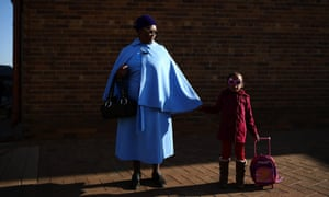 Elizabeth Gwele, 70 and granddaughter Tondo Gwele, 4 pose for a portrait outside the Rogina Mundi church in Soweto, South Africa. Speaking of Nelson Mandela Mrs Gwele said, 'For us he represents life, without him, we couldn't be what we are now. She ( her granddaughter) loves him. She calls him dada'. The former South African President and leader of the anti-apartheid movement has spent over a week in hospital after being admitted for a recurring lung infection.