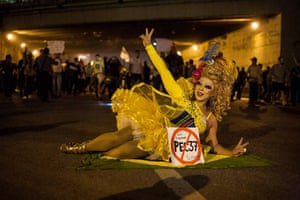 Brazil protests continue: A carnival dressed demonstrator gestures in Sao Paulo