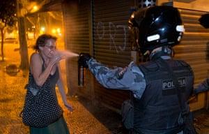 Brazil protests continue: Police pepper sprays a protester in Rio de Janeiro