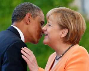 One kiss or two wonders Barack Obama as he is welcomed by German Chancellor Angela Merkel at the chancellery in Berlin, Germany.