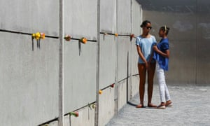 Barack Obama's daughters Sasha (right) and Malia visit the Berlin Wall memorial in Bernauer Strasss, Germany.