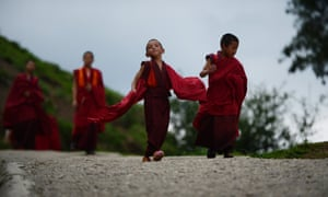 Six-year-old monk apprentice Tandi Dorji (centre) as he walks to breakfast at a monastery in Thimpu, Bhutan. Dorji is the youngest monk at the Buddhist monastery and he came to the monastery when he was five and was initially dropped off by his grandfather who lives with Dorji's mother in a remote village in eastern Bhutan.