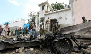 Somali security personnel guard the scene of a suicide bomb attack outside the UN base in Mogadishu
