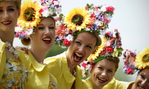 Members of The Tootsie Rolls, a retro girl band, laugh during the second day of Royal Ascot, in Berkshire.