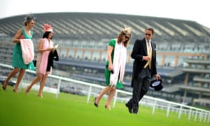 Racegoers walk towards the grandstand on day two at Ascot Racecourse.