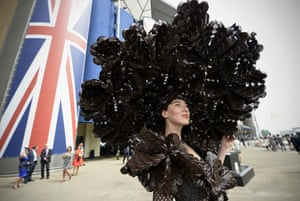 Larisa Katz, wearing an outfit made from chocolate packaging (but hopefully not chocolate in this heat), poses for a photograph during the second day of Royal Ascot, UK.