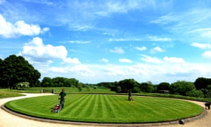 Gardeners tend to the grass in the sun at Belsay Hall in Northumberland as the UK basks in the sunshine.