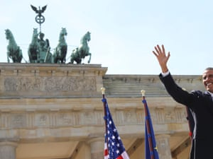 Barack Obama waves as he arrives to give a speech in front of the Brandenburg Gate at Pariser Platz in Berlin.