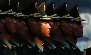 Members of an honour guard stand in line as they prepare for a welcoming ceremony for visiting Vietnamese President Truong Tan Sang outside the Great Hall of the People in Beijing, China.