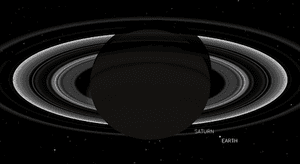 A simulation of Saturn with Earth in the background.